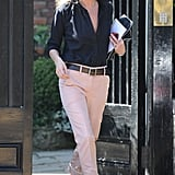 Kate Moss gave us a master class in closet essentials, styling up a pair of pastel trousers and a classic button-down and heels.