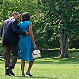 Barack kept his arm around Michelle as they walked together.