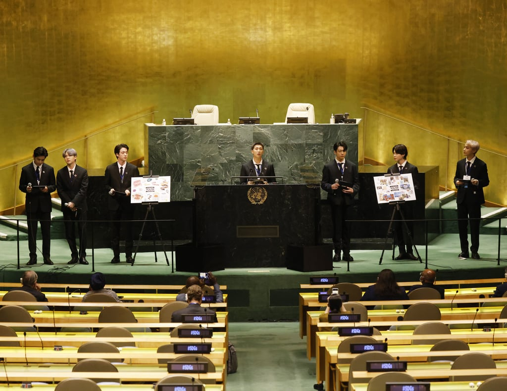 """It's been (another) big month for BTS. Shortly after picking up some wins at the MTV Video Music Awards, the group appeared at the 76th session of the United Nations General Assembly in New York City on 20 Sept. as special envoys for South Korea. Jin, Jimin, J-Hope, Jungkook, RM, Suga, and V joined President Moon Jae-in in delivering remarks about the ongoing coronavirus pandemic, climate change, and how young people today are grappling with both. """"A more appropriate name would be the 'welcome generation.'"""" Whereas many young people today are being commonly referred to as """"COVID's lost generation,"""" BTS urged the world to reframe that thinking. """"I think it's a stretch to say they're lost, just because the path they tread can't be seen by grown-up eyes,"""" RM said. Jin added, """"A more appropriate name would be the 'welcome generation' because instead of fearing change, this generation says, 'Welcome,' and keeps forging ahead."""" This wasn't the group's first visit to the esteemed global gathering: BTS met with the General Assembly in 2018 to help launch the Generation Unlimited initiative. This year, BTS also performed their new single """"Permission to Dance"""" in a video filmed at the UN headquarters. See highlights from their visit ahead.      Related:                                                                                                           It's Time For the Music Industry to Recognise Just How Influential K-Pop Is"""