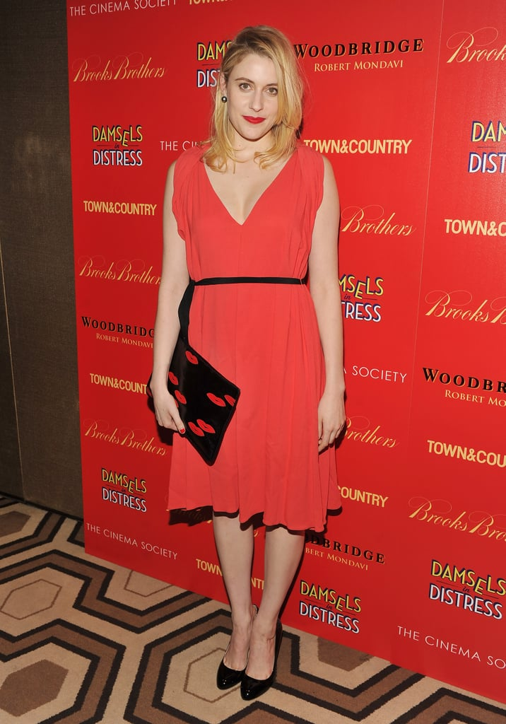 At an event in NYC in April 2012, the actress went bold in a red V-neck dress and a black clutch with adorable red lips all over it.  6855756