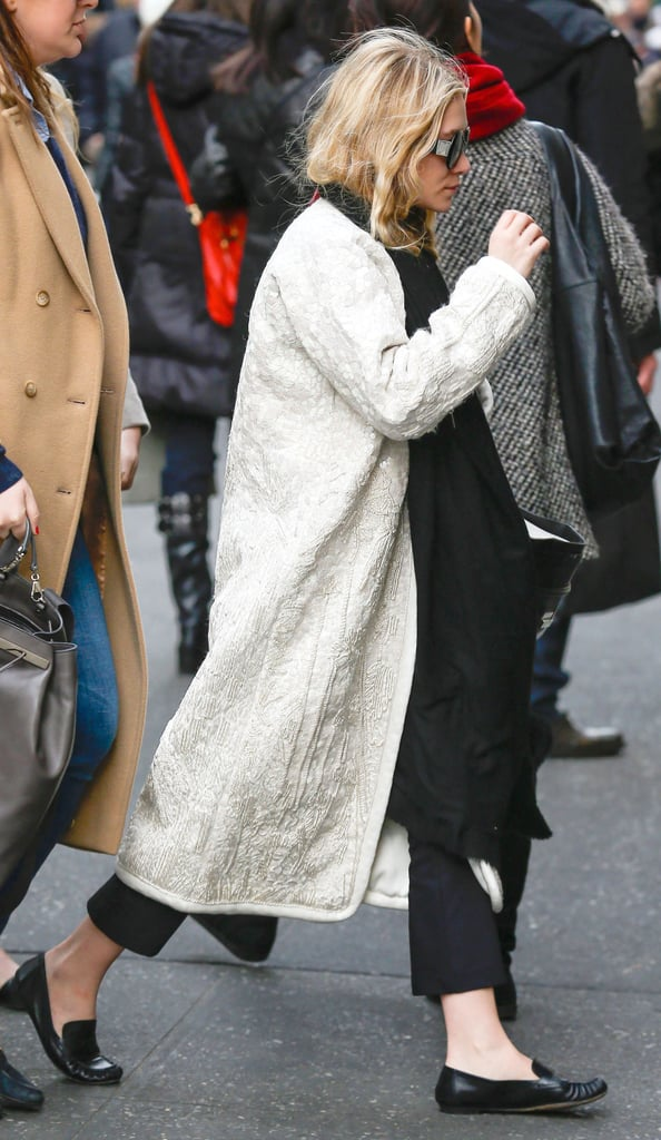 On her way into Bergdorf Goodman in NYC, Ashley Olsen showed off black-and-white Winter style in a long white coat, cropped pants, and loafers.
