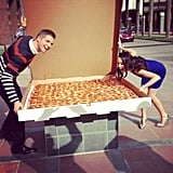E! News reporters Catt Sadler and Jason Kennedy celebrated the holidays with a giant pizza. Source: Instagram user iamcattsadler