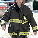 Jesse Spencer suited up in his fire gear while shooting scenes for Chicago Fire in Chicago on Friday.