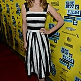 At the SXSW premiere of The Incredible Burt Wonderstone, Olivia donned a striped Dolce & Gabbana Spring 2013 dress paired with strappy Jimmy Choo sandals and Irene Neuwirth jewels.