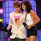 Selena Gomez and Justin Bieber smiled on stage during the June 2011 MuchMusic Awards in Toronto.