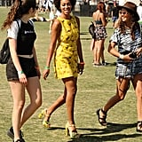 Solange Knowles wore a bright yellow dress and heels around Coachella in 2013.