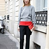 Layering with a purpose — her high-impact pop of red punched up a pair of classic trousers. We also love her not-so-basic Balenciaga lace-ups.