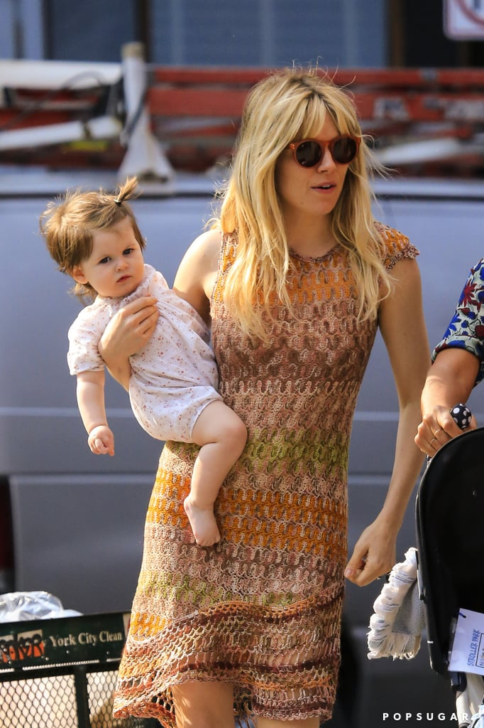 Sienna Miller cradled her daughter Marlowe Sturridge in NYC on Wednesday.