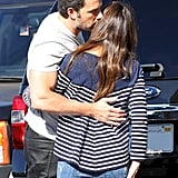 The couple stole a kiss during a stop at the farmer's market in October 2014.
