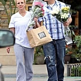 Britney Spears and a friend carried flowers.