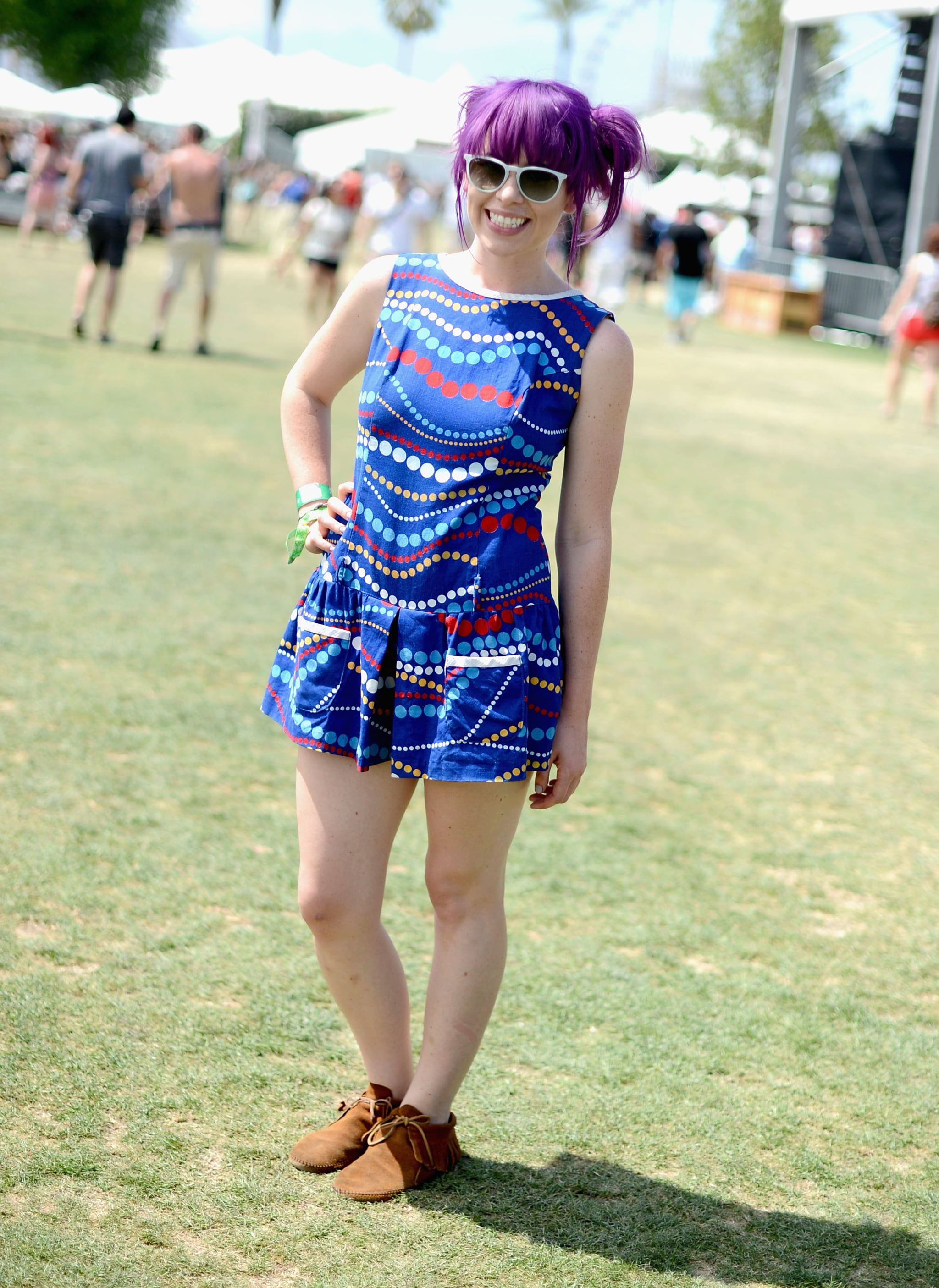 We love the way this festivalgoer swept her aubergine hair into matching buns.