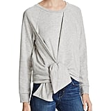 """""""We tend to live in our coziest clothes come Fall, so the least we can do is find some cooler versions of the stuff we love. This French Connection sweatshirt ($128) may just be the perfect intersection of fashion and function."""" — HWM"""