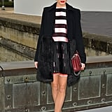 Outside the Dior show at Paris Fashion Week, Olivia Palermo showed off a pink-and-black-striped Dior dress, two-toned Dior pumps, and a red Dior chain-handle bag.