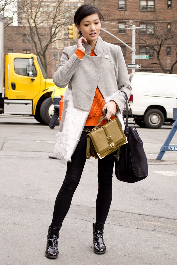Minimalist, but with a gorgeous coat and a polished satchel.