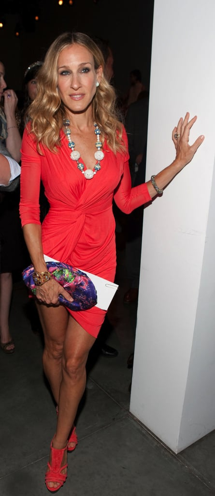 Looking red hot in head-to-toe Halston — a body-hugging wrap dress and coordinating sandals — and a white jade necklace by Lori Goldstein for Fred Leighton, SJP turned heads during the Spring 2011 Halston presentation.