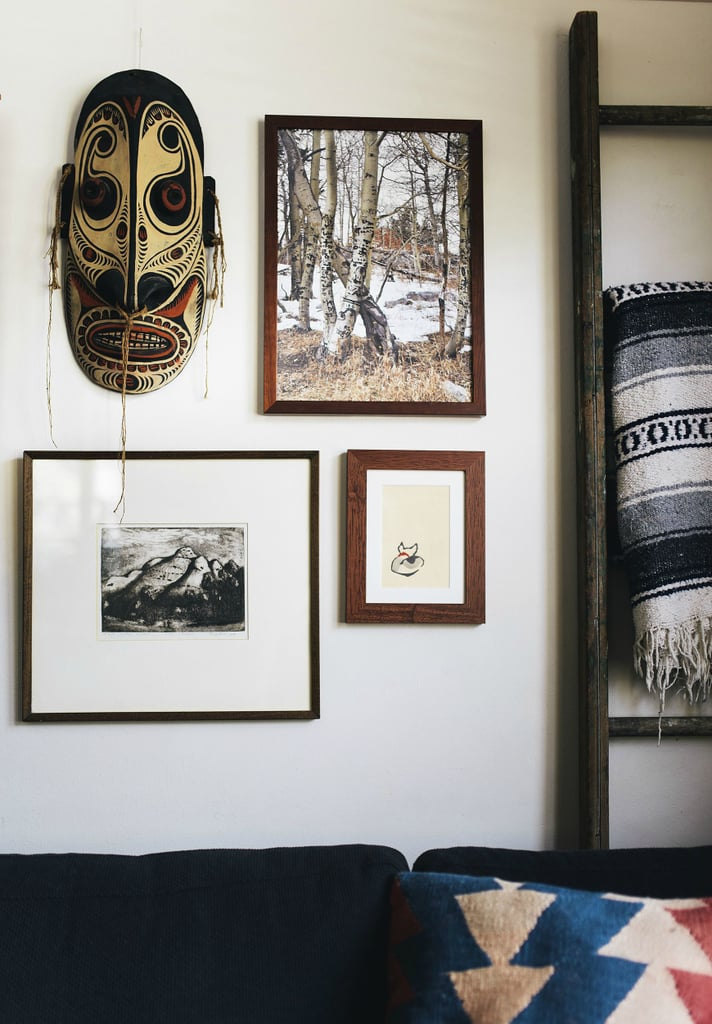 Tribal masks, unique art, and textiles add worldly interest to otherwise plain white walls.