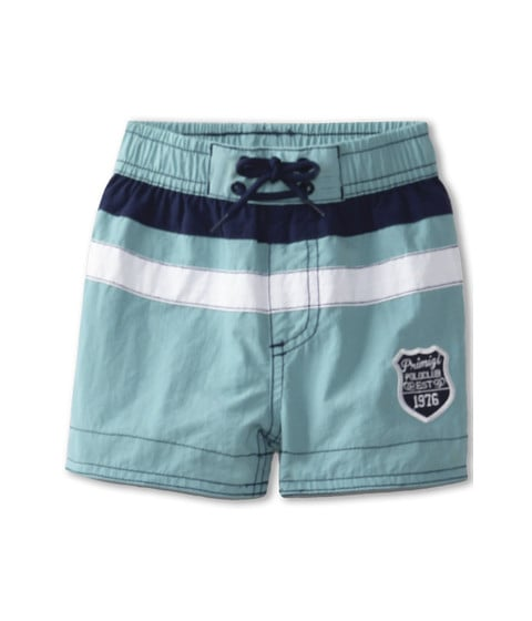 Primigi's classic swim trunks ($24) feature bold stripes and a regal-looking insignia.