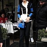 Wearing a sporty colorblock pantsuit with a Dior mini bag and tiny sunglasses. She finished off her look with Christian Louboutin heels.