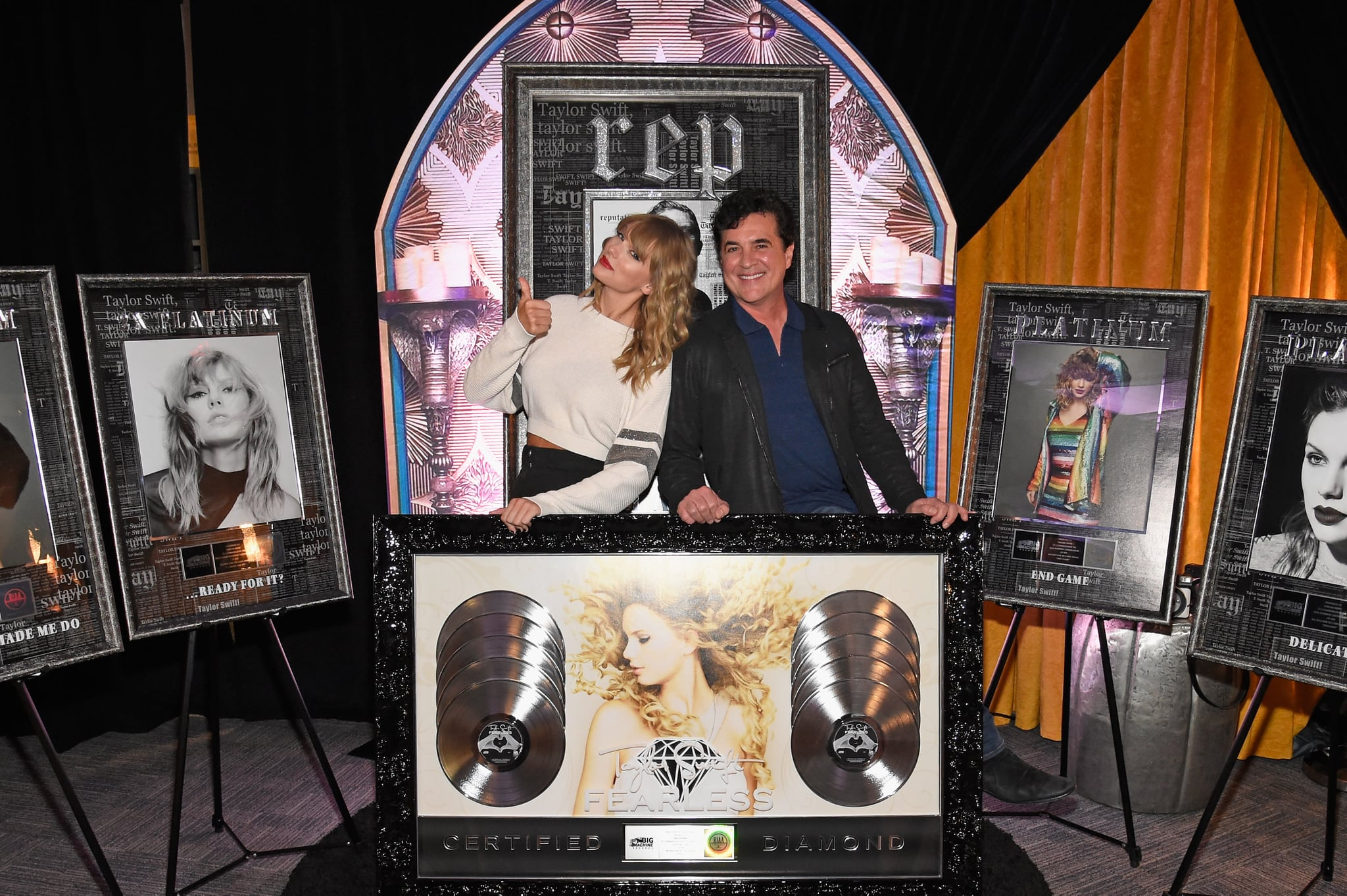 EAST RUTHERFORD, NJ - JULY 21:  Taylor Swift (L) and  CEO of Big Machine Records Scott Borchetta plaque presentation backstage at the Taylor Swift reputation Stadium Tour at MetLife Stadium on July 21, 2018 in East Rutherford, New Jersey.  (Photo by Kevin Mazur/TAS18/Getty Images for TAS)