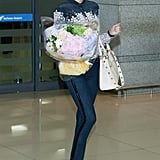 Miranda Kerr was given a bouquet when she arrived in South Korea.