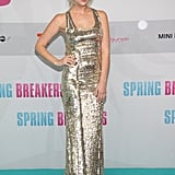 Ashley Benson glowed in a gold gown and gold Jerome C. Rousseau sandals at the Berlin premiere.