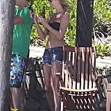 Stacy Keibler topped her bikini with denim shorts and a straw hat during a vacation in Mexico in March.