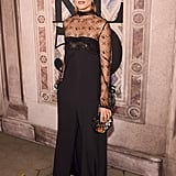 For Ralph Lauren's 50th anniversary show, Olivia looked elegant in a lace-topped black jumpsuit.