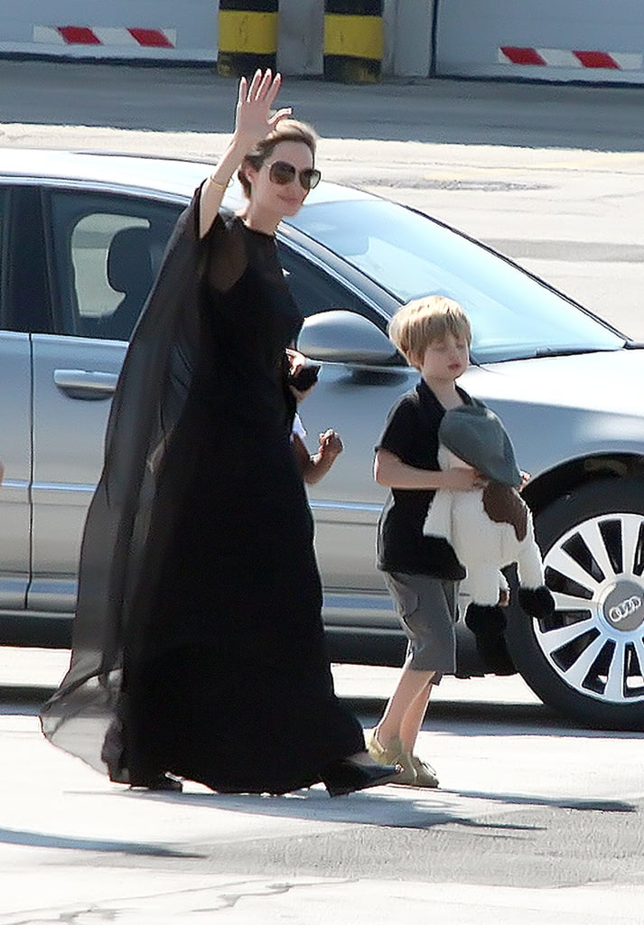Angelina Jolie landed in Sarajevo with her kids this afternoon. Shiloh carried a stuffed animal, while Pax and Zahara followed, close to their mom. Angelina is in Bosnia-Herzegovina to attend this evening's Sarajevo Film Festival, where she'll receive honorary citizenship. Last year, Angelina was honored at the festival with Brad Pitt by her side. She's since switched gears to film Maleficent in England and has been spotted on set in full costume. Shiloh, Pax, Knox, and Vivienne have all had the chance to visit her during production, which has included stunts that require Angelina to be suspended in the air on a crane.