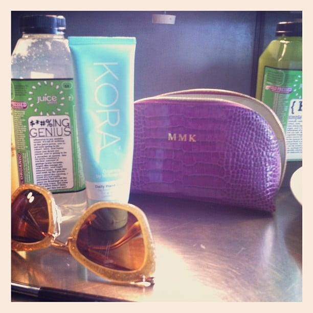 Sneak peek into Miranda Kerr's makeup essentials — a Kora prod (of course), sunnies, a personalisd makeup bag and water. Source: Instagram user mirandakerrverified