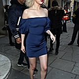 Selena wore a navy Cushnie et Ochs dress, blue bow Trademark slides, and Kate Young for Tura sunglasses while in London in 2017.