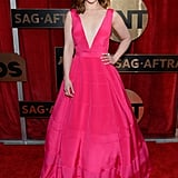 Emilia Clarke in plunging pink gown by Dior.