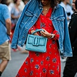 What better way to temper a punchy dress and bright bag than with a classic blue jean jacket?
