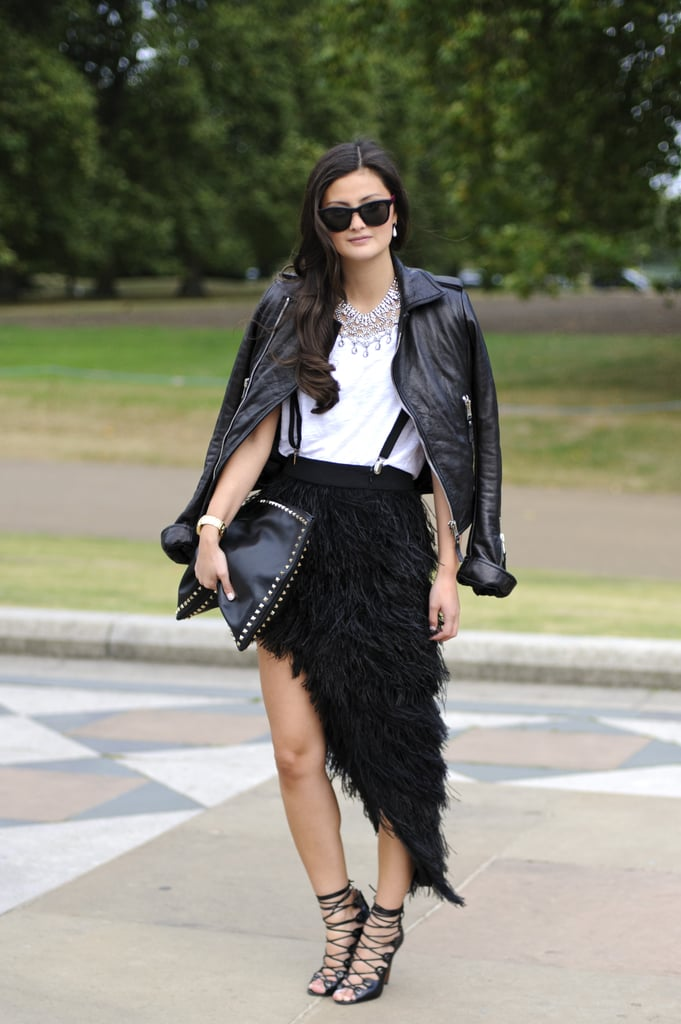 A whimsical, ruffled skirt and lace-up heels were tempered with a leather jacket.
