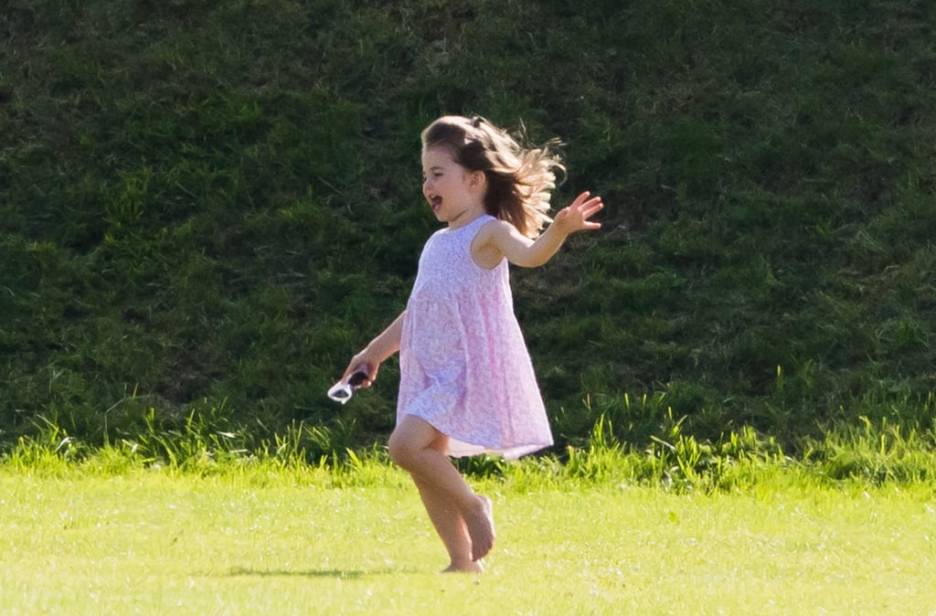 "By now, you've likely seen the adorable photos of Prince George and Princess Charlotte enjoying a day out with their mom, Kate Middleton, and other royal family members at Prince William's charity polo match in England last weekend. The event was full of cute moments from the kids — including George being pushed by his savage older cousin Savannah Phillips — but Charlotte really stole the show just by being her sassy, spirited self. During the afternoon outing, the 3-year-old princess looked completely carefree as she ran barefoot through the grass, showed off her somersaulting skills, and generally basked in the delight of being, well, a 3-year-old princess.       Related:                                                                                                           20 Facts About Princess Charlotte That Will Make Her Your Favorite Royal               To say that these photos of Charlotte make me wish I were a little kid again is a real understatement. Being an adult is cool, but it's no picnic — and with warmer days upon us, I just really miss rolling around in grass, running around with my cousins, and especially doing flips while wearing a dress and not caring about my ass hanging out. What a dream, right? Charlotte has quickly become my favorite member of the royal family this year (sorry, Queen), and these photos are a prime example of why. She's adorable, yes, but she's also at that age where everything is magical, any place can be a playground, and there's no voice inside your head telling you to ""be afraid"" or ""slow down"" or ""not do cartwheels in a dress."" The world is her oyster, and I want in.  I hope that these recent photos of Charlotte will inspire you, too, to be unbothered this Summer. Life is too short not to run, jump, and play, am I right? Scroll through for all the motivation you need to throw your arms up and act like a kid again."