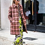 If this isn't flat-out fun fashion, what is? Olivia put her signature spin on quirky prints and ladylike separates at Paris Fashion Week for a playful outfit that didn't short on the cool factor. We're also seriously smitten with those bow-adorned flats.
