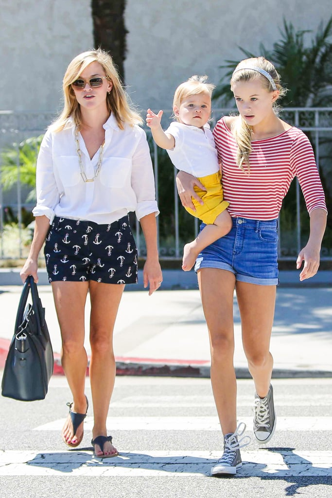 Reese Witherspoon brought two of her kids, Ava Phillippe and Tennessee Toth, for a daytime outing at the Brentwood Country Mart in LA on Saturday. Reese sported a pair of nautical-inspired J.Crew shorts while her look-alike daughter Ava showed off big sister skills by carrying her baby brother down the street. This is the first time we've seen Reese out about since late last month. She spent most of her Summer mixing work and play, including a Taylor Swift concert and getaway to the Bahamas. Professionally, Reese has had a busy couple of months with her line-up of big-screen projects. She filmed the crime drama Inherent Vice with Joaquin Phoenix and Josh Brolin, and was tapped to star in the film adaptation of Wild. Reese has also been making lots of progress with Gone Girl, which she is producing. The film garnered lots of buzz when Ben Affleck and Rosamund Pike were cast as the lead characters, and it was recently announced that Tyler Perry, Patrick Fugit and Neil Patrick Harris have joined the project as well.