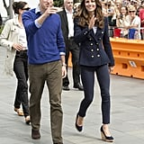 Arriving in Auckland, Kate wore dark skinny jeans, her beloved Stuart Weitzman wedge shoes, and a navy double-breasted blazer.