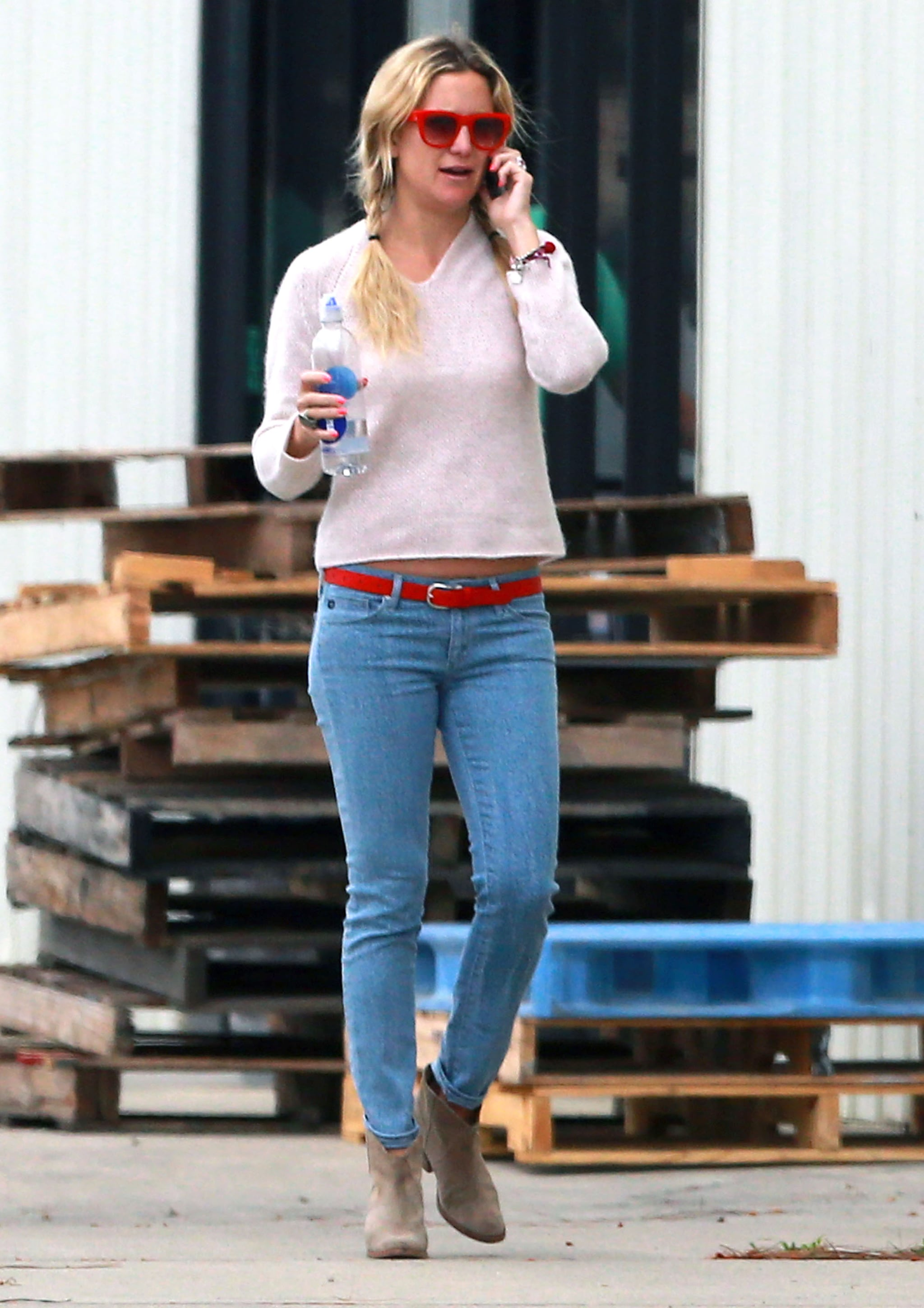 Kate Hudson talked on her phone at a winery.