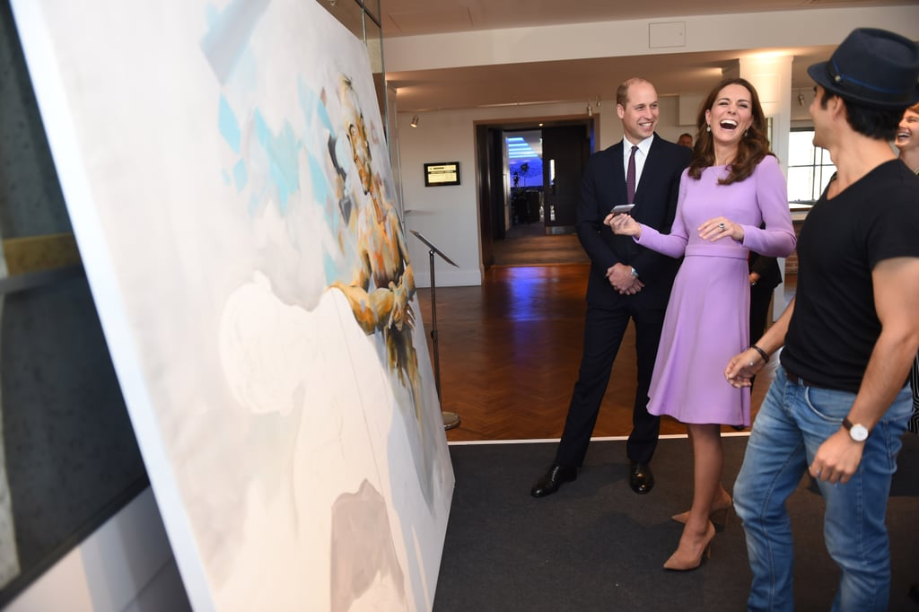 "Prince William and Kate Middleton are officially back in action! On Tuesday, the couple made their first joint appearance since welcoming Prince Louis as they visited a Global Ministerial Mental Health Summit at County Hall in London. While we couldn't get enough of their sweet photos together, it was a clip from their appearance that really made us smile. As the two met with Columbian artist Dairo Vargas, they gave a rare glimpse of their playful sides as they added some of their own brushwork to his painting. After Kate made a little stroke to the painting, Will jokingly said, ""It's pretty much ruined the picture,"" causing the pair to erupt into laughter.  It's not very often that the two put their love on full display, so their latest outing was a special treat. While the pair usually refrain from showing PDA during official appearances, they have snuck in a kiss or hand-holding over the years. See the cute video from their recent visit ahead!"
