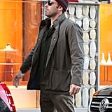 Ben Affleck kept warm in a jacket as he put some shopping bags in his car.