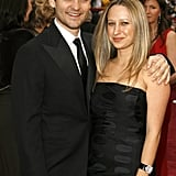 Tobey Maguire and Jennifer Meyer stuck together on the red carpet.