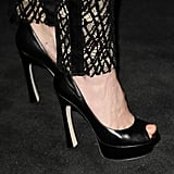 Black platform peep-toes with unique curved heels were January Jones's shoe choice at the Chanel dinner.