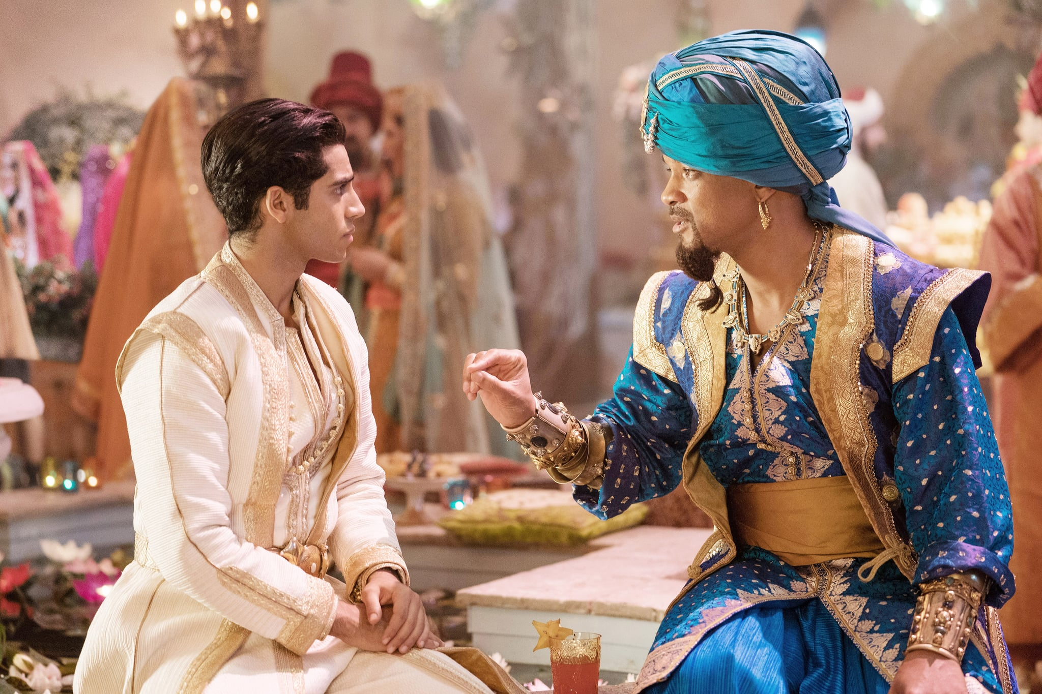ALADDIN, from left: Mena Massoud as Aladdin, Will Smith as the Genie, 2019. ph: Daniel Smith /  Walt Disney Studios Motion Pictures / courtesy Everett Collection