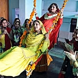 Two Indian girls swing during the Teej festival celebrations at Khalsa college for women in Amritsar.