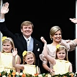King Willem-Alexander, Queen Maxima, and Princesses Catharina-Amalia, Ariane, and Alexia waved from the balcony of the royal palace.