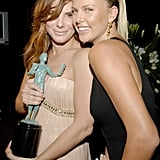 Sandra Bullock and Charlize Theron snapped a photo backstage at the January 2006 SAG Awards in LA.