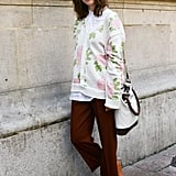 Boy-meets-girl styling with a slouchy rose-print cardi and oxfords.