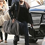 Orlando Bloom carried his bags to a plane at LAX.