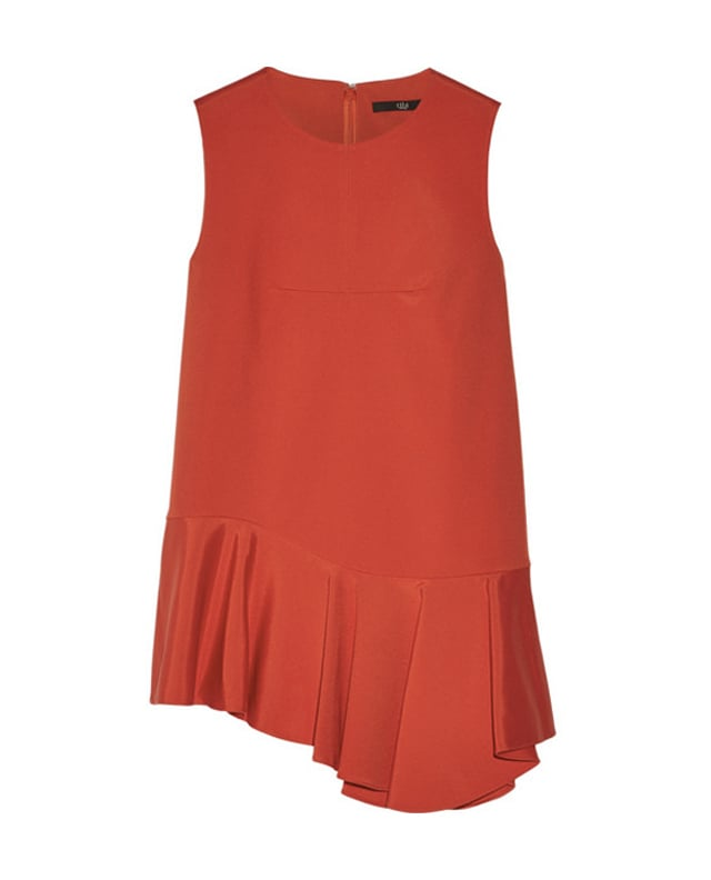 I'm attempting to inject more color into my wardrobe this year, starting with this  Tibi scarlet red top ($345). The vibrant color and ruffle hemline makes it a chic and flirty option for Valentine's Day.    — JC