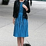 Miranda paired a leather jacket with a chic blue dress.